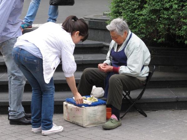 Shanghai-China-Elderly-Woman-Purchasing-Trinket-Street-Sewing