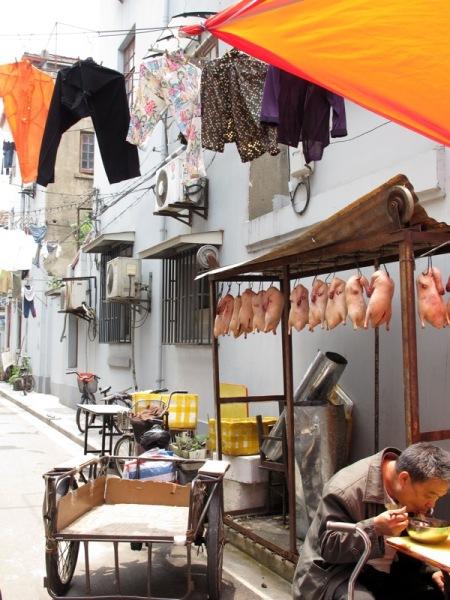 Shanghai-China-Photograph-Hanging-Ducks-Clothes