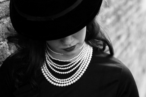 Stock-Rich-Woman-Pearls-Hat.png