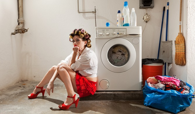 bigstock-laundry-woman-bored-housewife-home-cleaning