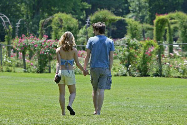 dating-man-woman-couple-park-walking-relationship