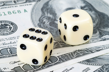 money-investments-cash-dice-risky
